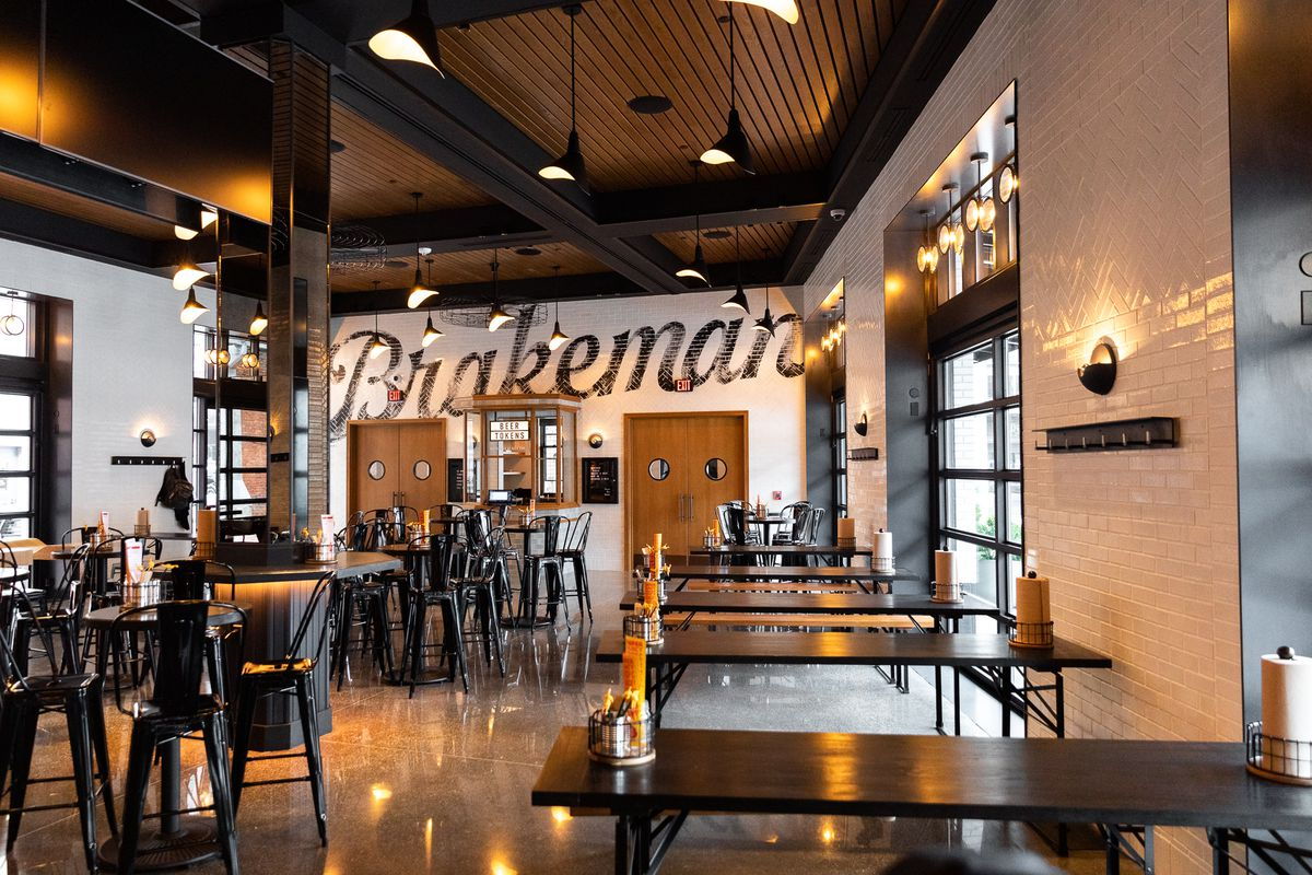 Tables inside the opened dining room at the Brakeman are surrounded by metal chairs and stools.