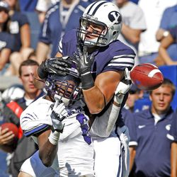Brigham Young Cougars wide receiver Brett Thompson (19) grabs Weber State Wildcats cornerback Robbie Diamond (6) head instead of the ball as Brigham Young University defeats Weber State University in football 45-6 Saturday, Sept. 8, 2012, in Provo, Utah.
