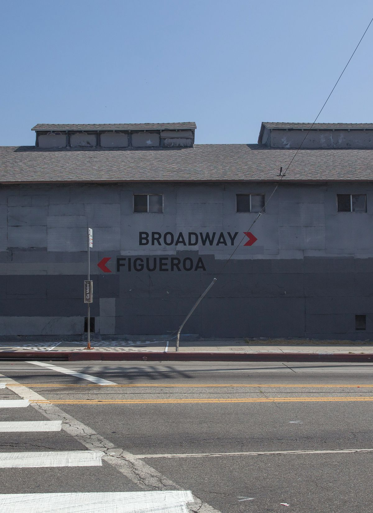 Sign pointing to Broadway and Figueroa