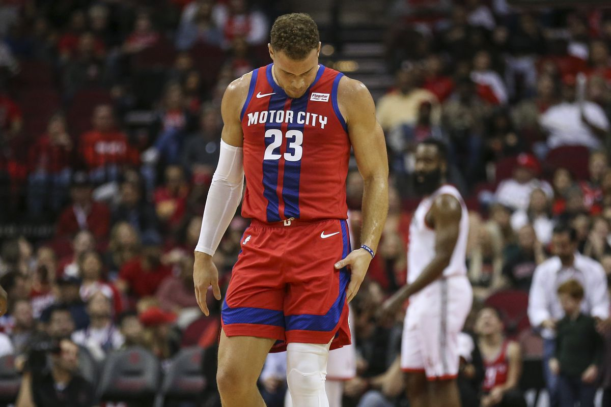 Detroit Pistons forward Blake Griffin grabs his leg after a play during the first quarter against the Houston Rockets at Toyota Center.
