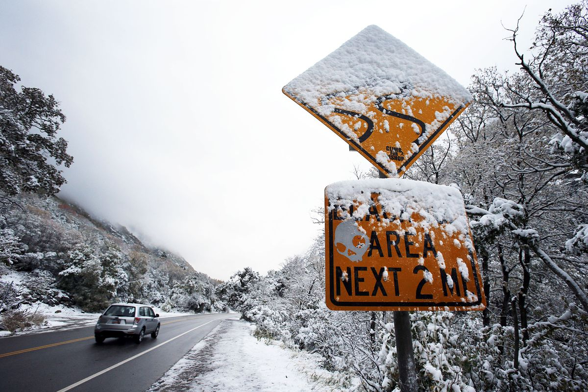 A car travels in Little Cottonwood Canyon in 2013. The Utah Department of Transportation is looking at two other options to handle traffic in the canyon: a cog railway or a gondola to ferry visitors to the ski resorts.