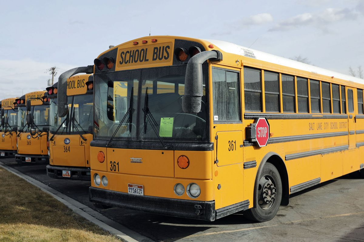 School buses are parked outside of the Salt Lake City School District's Pupil Transportation building in Salt Lake City on Thursday, Feb. 11, 2021.
