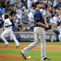 Tampa Bay Rays starting pitcher James Shields reacts on the mound as New York Yankees' Eduardo Nunez rounds third base after hitting a solo home run in the second inning of a baseball game, Saturday, Sept. 15, 2012, at Yankee Stadium in New York. The Yankees won 5-3.