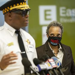 Mayor Lori Lightfoot listens as Chicago Police Supt. David Brown gives the media an update on an officer's condition and investigation after the shooting of the off-duty police officer at the University of Chicago Medical Center in Hyde Park, Monday afternoon, March 15, 2021.