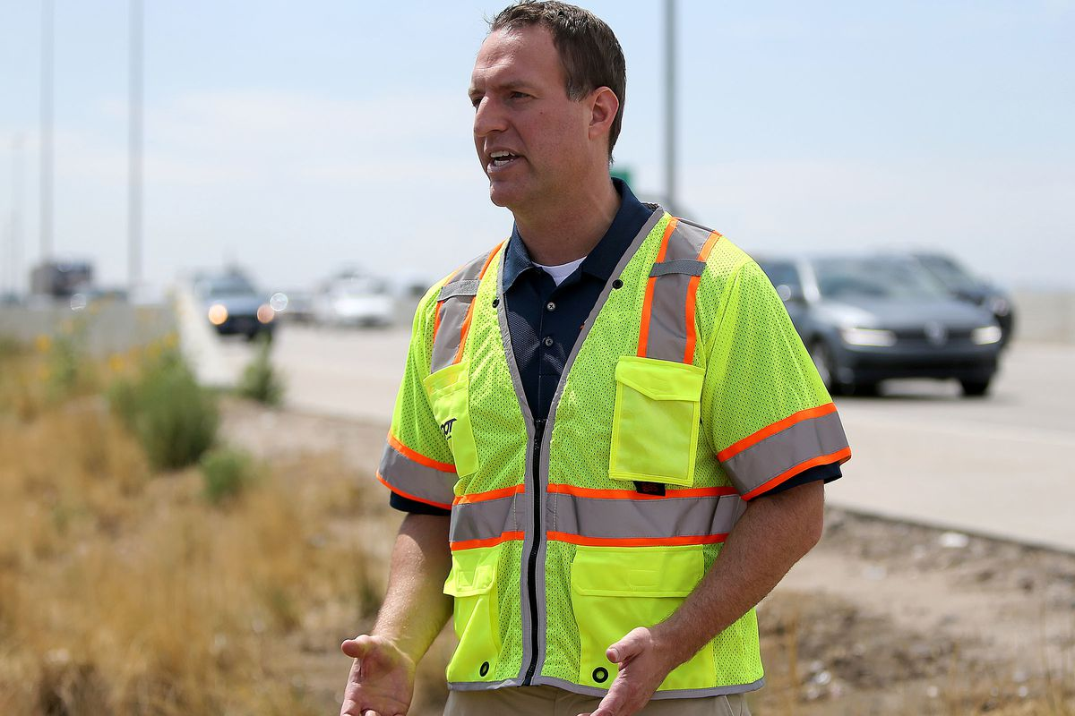FILE - John Gleason, spokesman for the Utah Department of Transportation, stands on the side of I-15 in Murray on Wednesday, Aug. 16, 2017.