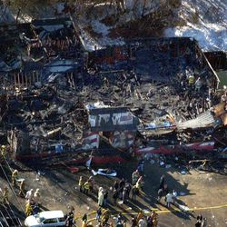 FILE - The burned out remains of the Station nightclub in West Warwick, R.I. is seen in a Feb. 21, 2003 file aerial photo. The owner of the site of a 2003 nightclub fire that killed 100 people is donating the land for a permanent memorial, bringing an end to a years-long effort to secure the site of The Station fire by families of those killed and survivors of the blaze. Dan McKiernan, a lawyer for property owner Ray Villanova, filed papers at West Warwick Town Hall that transferred ownership of the plot of land to the Station Fire Memorial Foundation on Friday, Sept. 28, 2012.