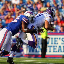 Aug 16, 2013; Orchard Park, NY, USA;  Buffalo Bills outside linebacker Jerry Hughes (55) sacks Minnesota Vikings quarterback Christian Ponder (7) during the first quarter at Ralph Wilson Stadium.