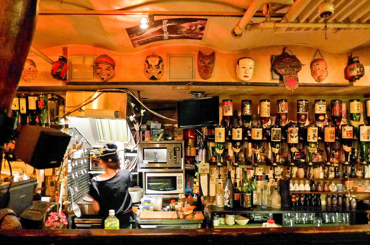 A person behind the bar at Sake Bar Decibel