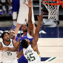 Utah Jazz guard Donovan Mitchell (45) floats up a shot over LA Clippers forward Serge Ibaka (9) as the Utah Jazz and LA Clippers play in an NBA basketball game at Vivint Smart Home Arena in Salt Lake City on Friday, Jan. 1, 2021. Utah won 106-100.