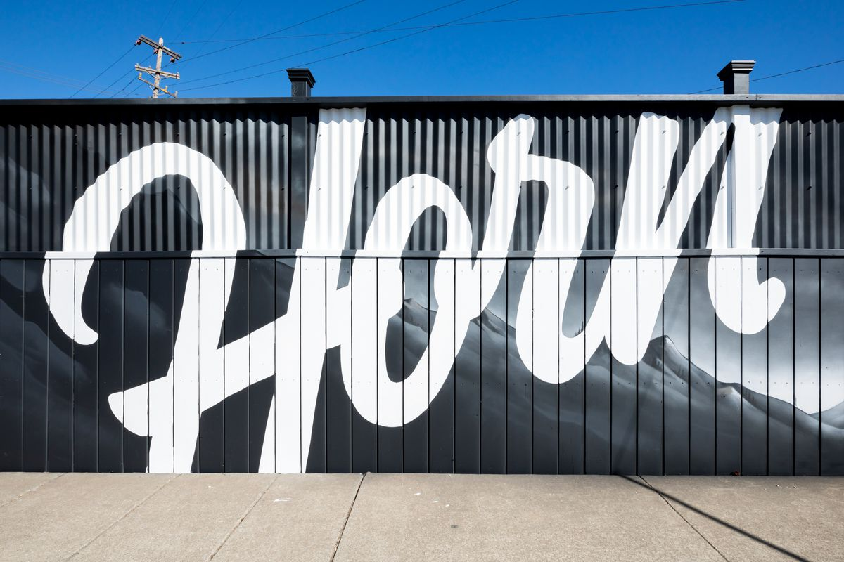 """""""Horn"""" painted in white cursive on the outside of the restaurant"""