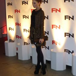 Olivia Palermo walking the red carpet while supporting friend and shoe designer Charlotte Dellal