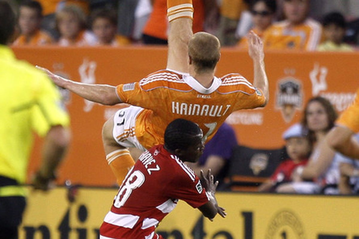 HOUSTON - MAY 28: Andre Hainult #31 of the Houston Dynamo clears the ball away from Marvin Chavez #18 of FC Dallas during the first half at Robertson Stadium on May 28, 2011 in Houston, Texas. (Photo by Bob Levey/Getty Images)