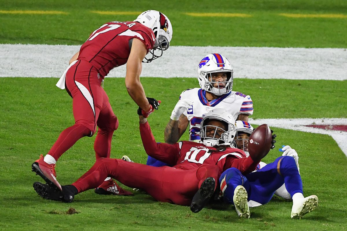 Wide receiver DeAndre Hopkins #10 of the Arizona Cardinals celebrates with wide receiver Andy Isabella #17 after Hopkins caught the game-winning touchdown pass during the second half against the Buffalo Bills at State Farm Stadium on November 15, 2020 in Glendale, Arizona.
