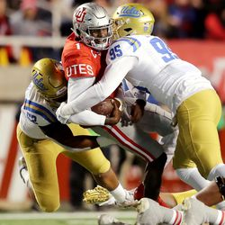 Utah Utes quarterback Tyler Huntley (1) is sacked by UCLA Bruins linebacker Lokeni Toailoa (52) and UCLA Bruins linebacker Jason Harris (95) as Utah and UCLA play a college football game in Salt Lake City at Rice-Eccles Stadium on Saturday, Nov. 16, 2019.