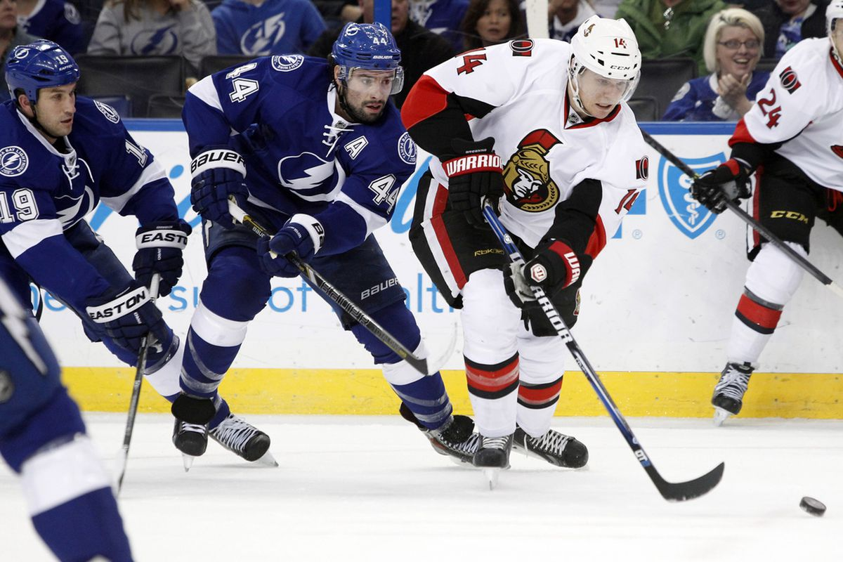 Tampa Bay's Nate Thompson and Ottawa's Colin Greening pursue the puck during the Lightning's 4-3 shootout win in Tampa Thursday night