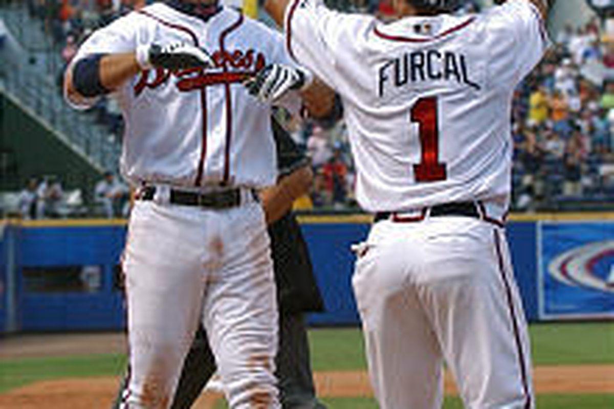 Atlanta's Chipper Jones, left, celebrates with Braves Rafael Furcal (1) after hitting a two-run home run.