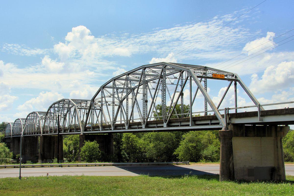 Metal truss bridge over a river