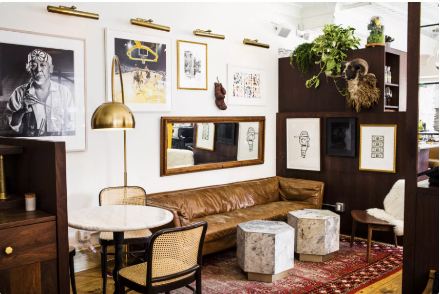 A living room-like restaurant interior with couches