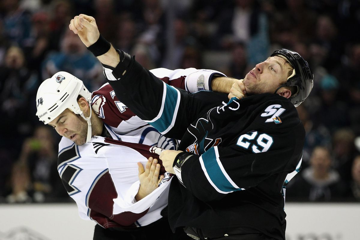 SAN JOSE, CA - DECEMBER 15:  Daniel Winnik #34 of the Colorado Avalanche and Ryane Clowe #29 of the San Jose Sharks fight during their game at HP Pavilion at San Jose on December 15, 2011 in San Jose, California.  (Photo by Ezra Shaw/Getty Images)