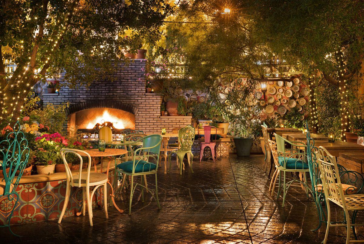A garden-like setting behind a bar