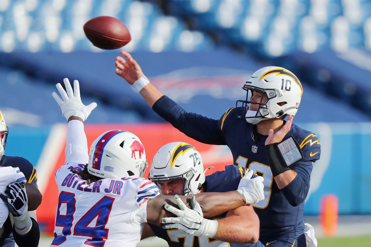 Justin Herbert #10 of the Los Angeles Chargers releases the ball during the first quarter against the Buffalo Bills at Bills Stadium on November 29, 2020 in Orchard Park, New York.