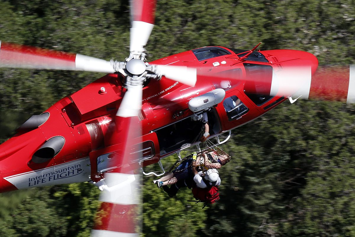 An 18-year-old female, seen in this 2016 file photo,  is hoisted by Life Flight from Lisa Falls in Little Cottonwood Canyon on Wednesday, July 6. The woman fell while hiking.