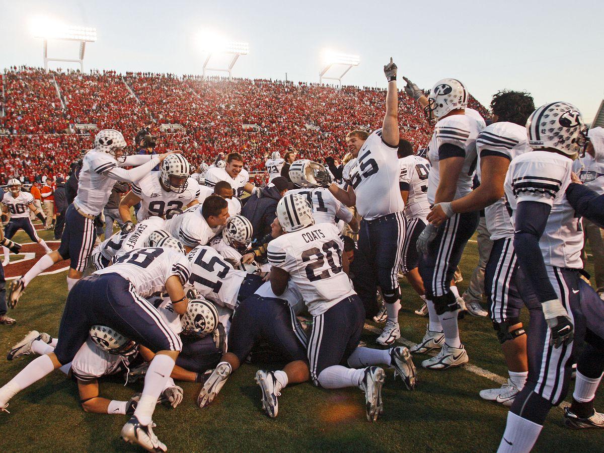 BYU player's celebrate Jonny Harline's game-winning touchdown after their 33-31 defeat of the University of Utah at Rice-Eccles Stadium in Salt Lake, Utah Saturday Nov. 25, 2006.
