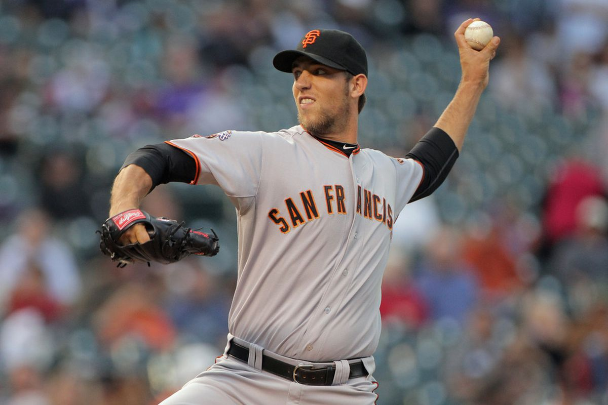 DENVER, CO - SEPTEMBER 16:  Starting pitcher Madison Bumgarner #40 of the San Francisco Giants delivers against the Colorado Rockies at Coors Field on September 16, 2011 in Denver, Colorado.  (Photo by Doug Pensinger/Getty Images)