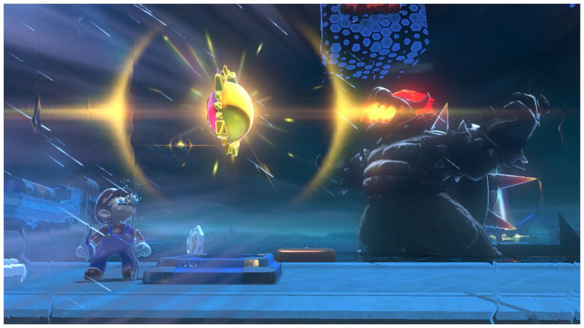 """In the foreground, Mario looks at a golden token called a """"cat shine."""" In the background, a kaiju-sized Bowser prepared to spit flames. This is one of those overly-staged screens that I spent way too much time trying to capture."""