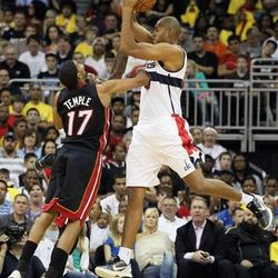 Washington Wizards forward Brian Cook (43) is fouled as Miami Heat guard Garrett Temple (17) and another Heat player defend during the second half of an NBA preseason basketball game, Wednesday, Oct. 24, 2012, in Kansas City, Mo. The Wizards won 101-94.