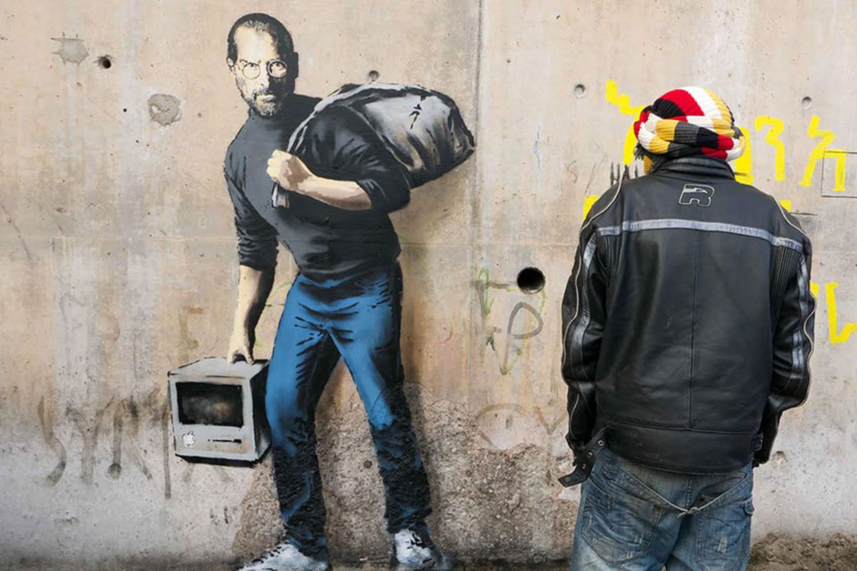 A Banksy mural in a refugee camp in Calais, France.