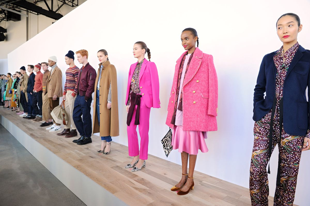 Models stand in a line at J.Crew's New York Fashion Week presentation.
