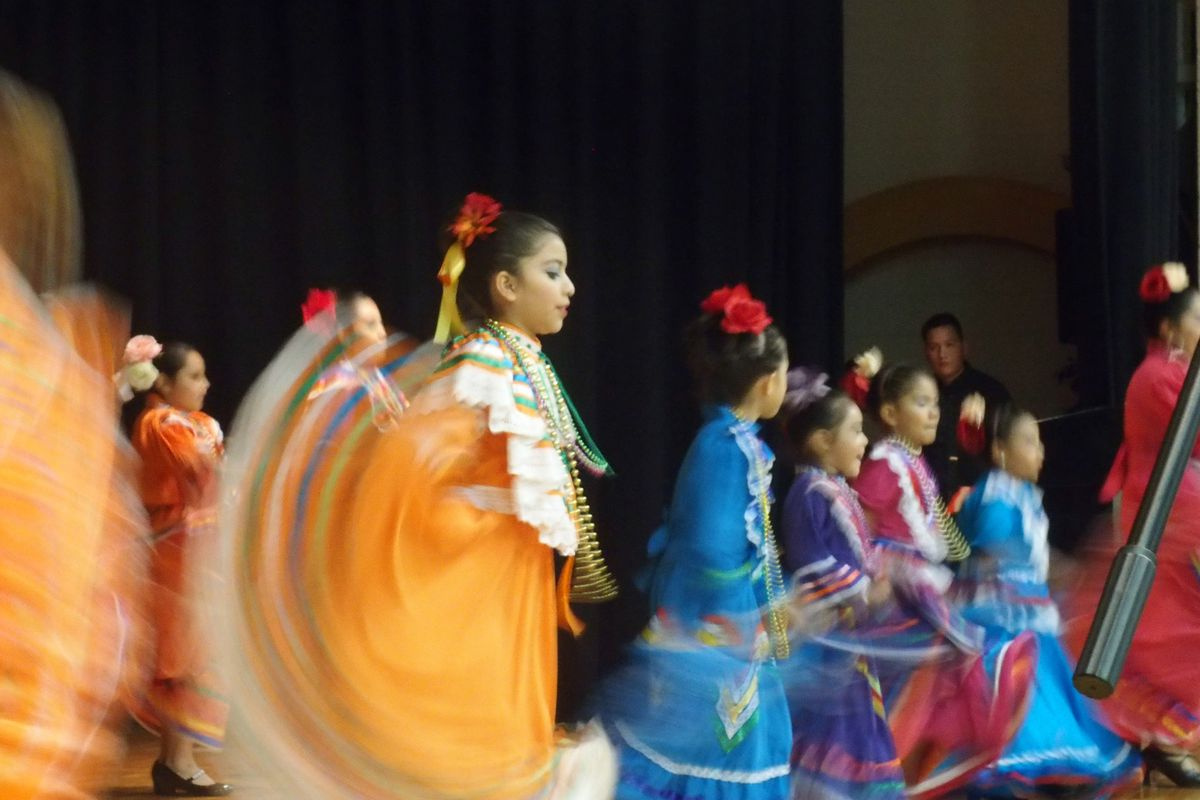 Students dance with their mothers at a Hispanic Heritage Month celebration in October.
