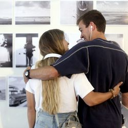 """Lizzy Braby and Christian Bain look at photography by Dani Mattson, paired with the song """"A Dustland Fairytale,"""" by the Killers, at the Synesthesia art show, organized by Ella Ballstaedt, at the State House in Orem on Friday, June 12, 2020. Each piece of artwork has a suggested song to listen to while viewing the art."""