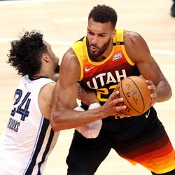 Utah Jazz center Rudy Gobert (27) goes at Memphis Grizzlies forward Dillon Brooks (24) as the Utah Jazz and the Memphis Grizzlies play in game 5 at Vivint Arena in Salt Lake City on Wednesday, June 2, 2021. Utah won 126-110, Utah advances to the second round.