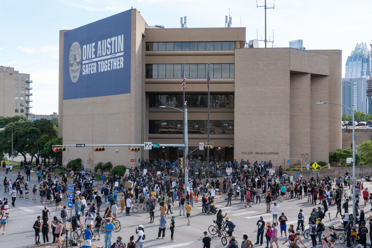 Protestors at the Austin Police Department headquarters in the downtown area on Saturday, May 30