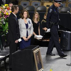 Erika Barney takes her place on the stand prior to funeral services for her husband, Unified Police Department officer Doug Barney, at the Maverik Center in West Valley City on Monday, Jan. 25, 2016.