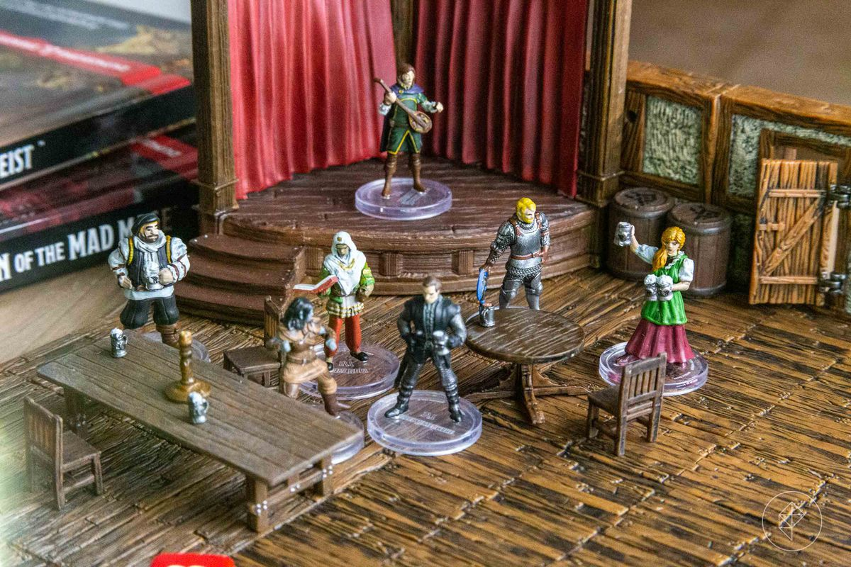 Seven miniatures standing in front of a stage where a bard is playing.