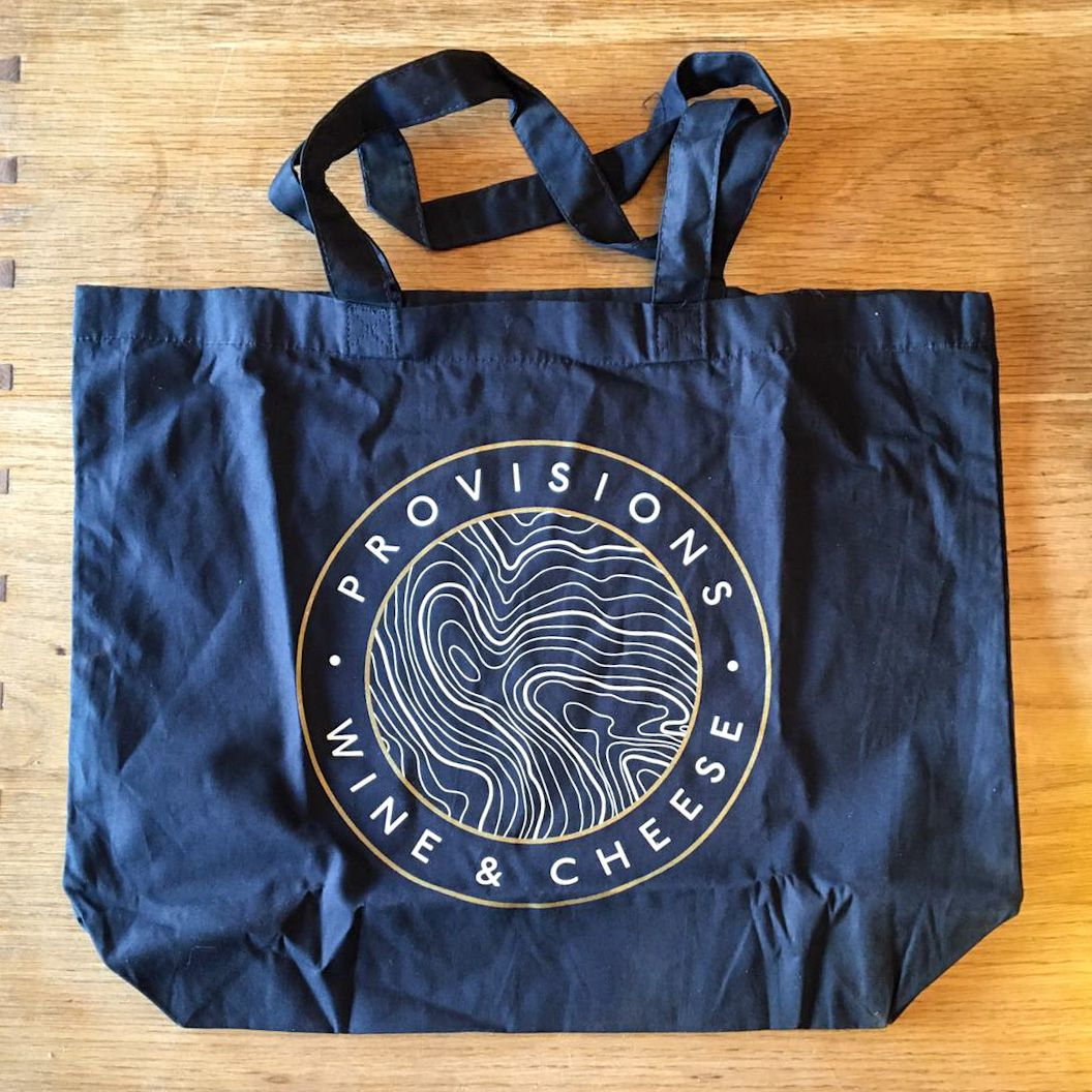 London's best restaurant merch includes this blue tote bag with Provisions deli branding