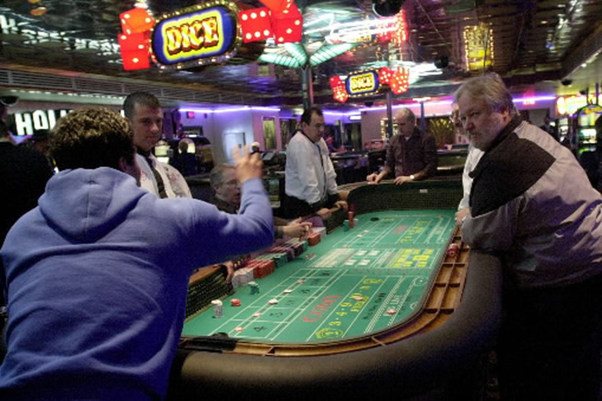 Gamblers play craps at Aurora's Hollywood Casino in 2001.