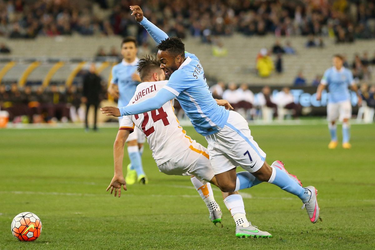 Raheem Sterling of Manchester City is tackled by Alessandro Florenzi of AS Roma during the International Champions Cup friendly match between Manchester City and AS Roma at the Melbourne Cricket Ground on July 21, 2015 in Melbourne, Australia.