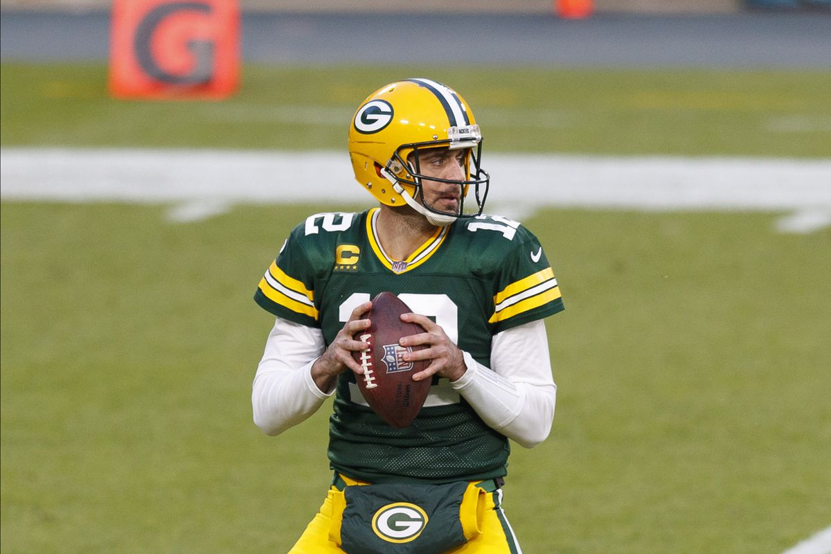 Green Bay Packers quarterback Aaron Rodgers (12) looks to throw a pass during the first quarter against the Philadelphia Eagles at Lambeau Field.