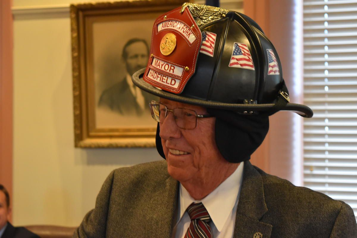 Mayor J.H. Hadfield wears a firefighter's helmet with his name on it. Fire Chief Aaron Brems presented Hadfield with the helmet during a recent City Council meeting for his service and support of public safety.