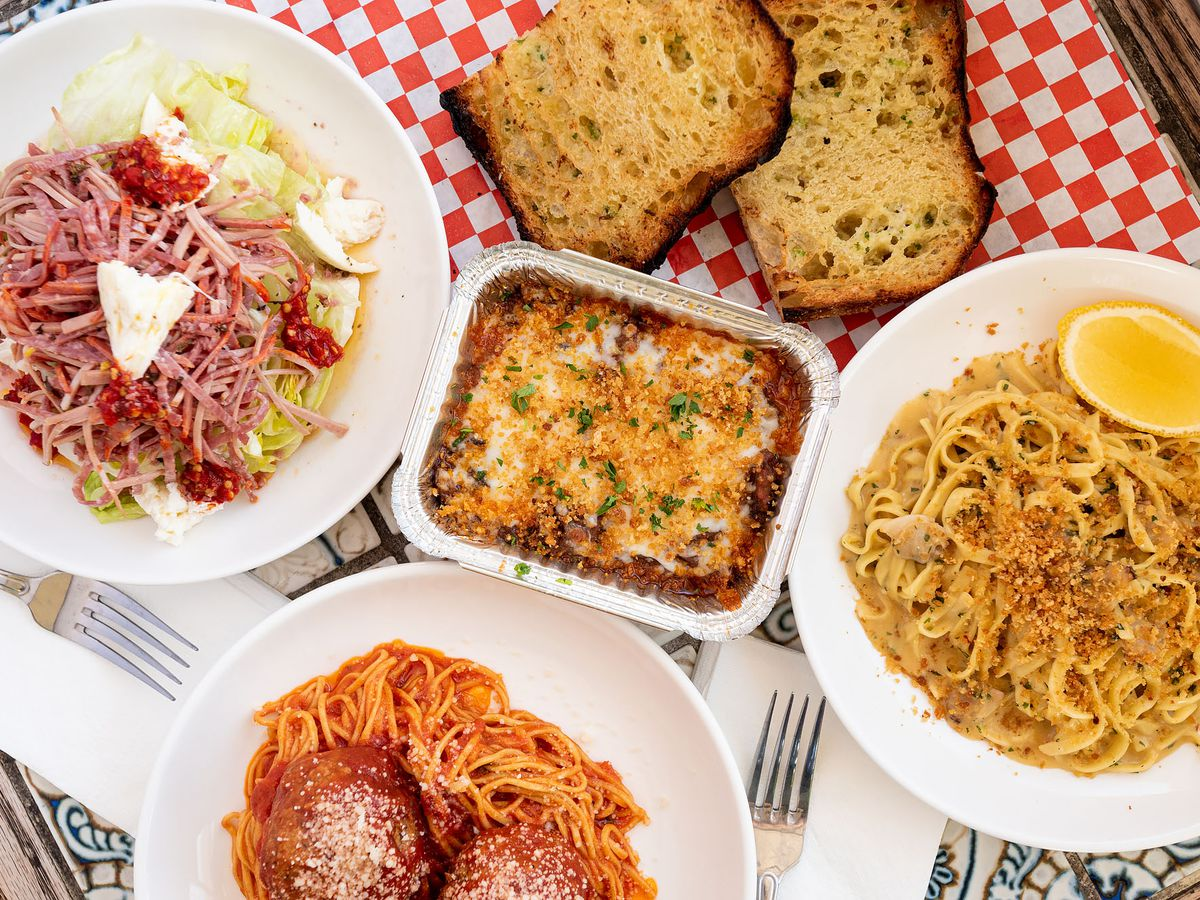 Dishes from Sunday Gravy, including spaghetti and meatballs