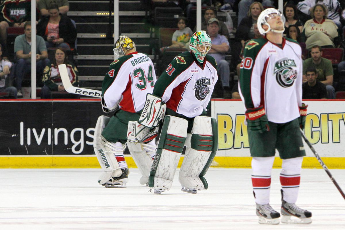 <strong>Chad Rau prays for mercy while Matt Hackett heads to the bench after goal #4, and Mike Brodeur takes his place. </strong><em>Photo by Morris Molina/Houston Aeros</em>