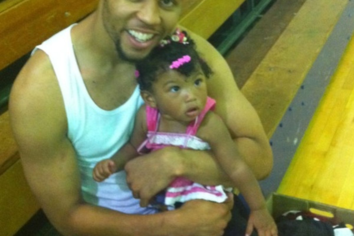 "<em>Brandon Roy holds Nate Robinson's daughter. Via <a href=""http://tweetphoto.com/39051320"" target=""new"">tweetphoto</a>.</em>"