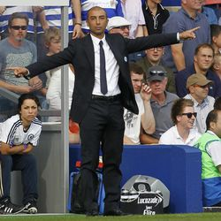 Chelsea's manager Roberto Di Matteo reacts as he watches his team play against Queens Park Rangers during their English Premier League soccer match at Loftus Road stadium, London, Saturday, Sept. 15, 2012.