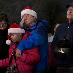 """Ed Snoddy, his wife, Janice Kimball, and his daughter, Carrie Anne Snoddy, attend the """"Homeless Persons' Memorial Candlelight Vigil"""" at Pioneer Park in Salt Lake City on Tuesday, Dec. 13, 2016. The vigil honors all the homeless people who have died in the past year  As of that evening, 97 homeless people had died in the Salt Lake area in 2016."""