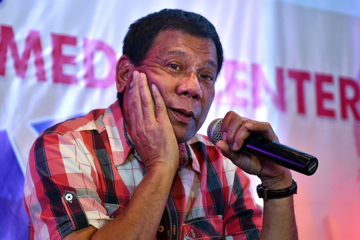 Rodrigo Duterte speaks to journalists during a press conference.
