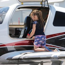 Trinelle Hardinger looks inside a Cessna TTX plane during the Skypark Aviation Festival and Expo at Skypark Airport in Woods Cross on Friday, June 2, 2017. The expo is Utah's largest annual aviation event.